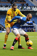 Ciaron Brown (Livingston) is held off by Kemar Roofe (Rangers) during the Scottish Premiership match between Rangers and Livingston at Ibrox, Glasgow, Scotland on 25 October 2020.