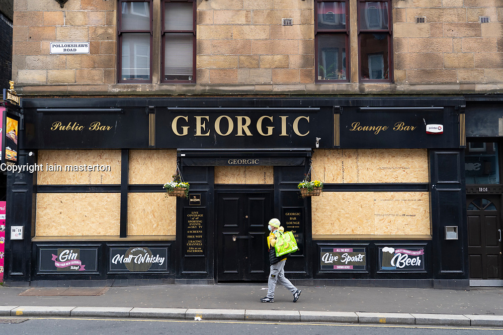 Glasgow, Scotland, UK. 3 April, 2020. Images from the south side of Glasgow at the end of the second week of Coronavirus lockdown. Georgic pub in Shawlands in closed and boarded up.  Iain Masterton/Alamy Live News