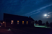Blue Moon at Ghostown Blues Bed & Breakfast, Maple Creek, Saskatchewan. Concert goers at Belle Plaine performance take a break during intermission to get some fresh air under the blue moon.