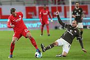 Fussball: 2. Bundesliga, FC St. Pauli - VFL Bochum, Hamburg, 28.01.2021<br /> Robert tesche (Bochum, l.) - Rico Benatelli (Pauli)<br /> © Torsten Helmke