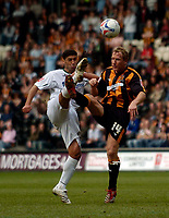 Photo: Jed Wee/Sportsbeat Images.<br /> Hull City v Norwich City. Coca Cola Championship. 06/04/2007.<br /> <br /> Norwich's Youssef Safri (L) and Hull's Ray Parlour battle for the ball.