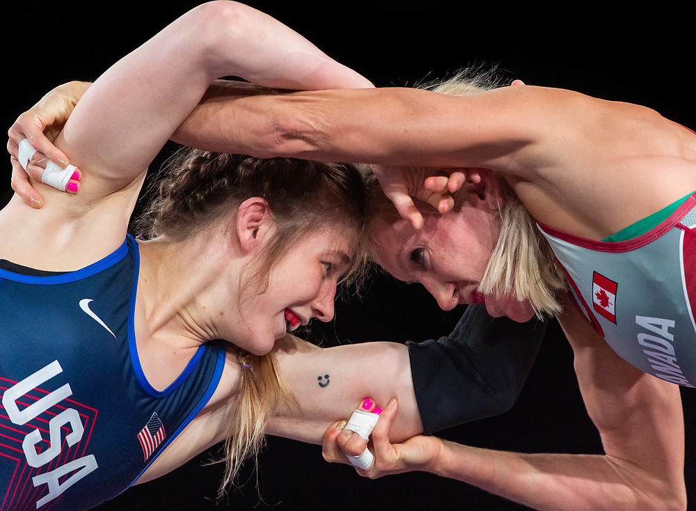 OTTAWA - MARCH 14: American Sarah Hildebrandt battles with Canadian Jessica MacDonald in the 50kg division of the Wrestling Pan-American Olympic Qualification tournament at the Shaw Centre in Ottawa, Canada on March 14, 2020.<br /> <br /> Photo: Steve Kingsman for Sports Ottawa
