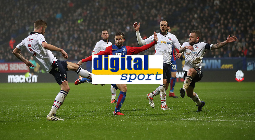 Football - 2016 / 2017 FA Cup - Third Round: Bolton Wanderers vs. Crystal Palace<br /> <br /> Rohan Cabaye of  Crystal Palace is challenged by Mark Beevers, Tom Thorpe and Jay Spearing of Bolton Wanderers during the match at Macron Stadium.<br /> <br /> COLORSPORT/LYNNE CAMERON