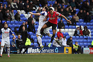 Tranmere Rovers' Steven Jennings jumps with Oldham Athletic's Korey Smith. Skybet football league 1match, Tranmere Rovers v Oldham Athletic at Prenton Park in Birkenhead, England on Saturday 1st March 2014.<br /> pic by Chris Stading, Andrew Orchard sports photography.