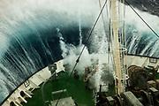 Wave breaking over bow of tourist ship Marina Svetaeva, Southern Ocean, Antarctica