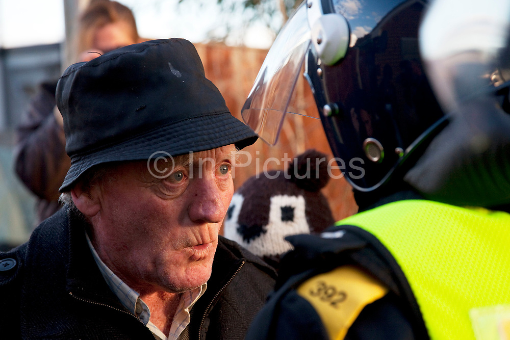 Traveller remonstrates with police about the treatment of his people. Protesters who barricaded themselves above the entrance to the Dale Farm travellers' site have been removed by police as bailiffs prepare to move in. Essex Police cleared the scaffolding structure so it could be dismantled and machinery driven in by bailiffs to evict the travellers. On Wednesday night Essex Police said that over the course of the day 23 people had been arrested. Clearance of Dale Farm prior to eviction. Riot police and bailiffs were present on 19th October 2011, as a scaffolding gantry was cleared of protesters so the site could be cleared. Dale Farm is part of a Romany Gypsy and Irish Traveller site on Oak Lane in Crays Hill, Essex, United Kingdom. Dale Farm housed over 1,000 people, the largest Traveller concentration in the UK. The whole of the site is owned by residents and is located within the Green Belt. It is in two parts: in one, residents constructed buildings with planning permission to do so; in the other, residents were refused planning permission due to the green belt policy, and built on the site anyway.