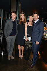 Left to right, EDDIE REDMAYNE, CINDY CRAWFORD, CLAIRE FORLANI and DOUGRAY SCOTT at the OMEGA VIP dinner hosted by Cindy Crawford and OMEGA President Mr. Stephen Urquhart held at aqua shard', Level 31, The Shard, 31 St Thomas Street, London, SE1 9RY on 10th December 2014.