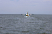 fishing boat out on the open sea.