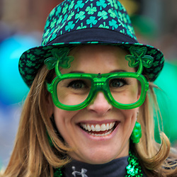 York, PA / USA - March 12, 2016: A woman wears green clover glasses in Irish spirit at the annual Saint Patrick's Day Parade.