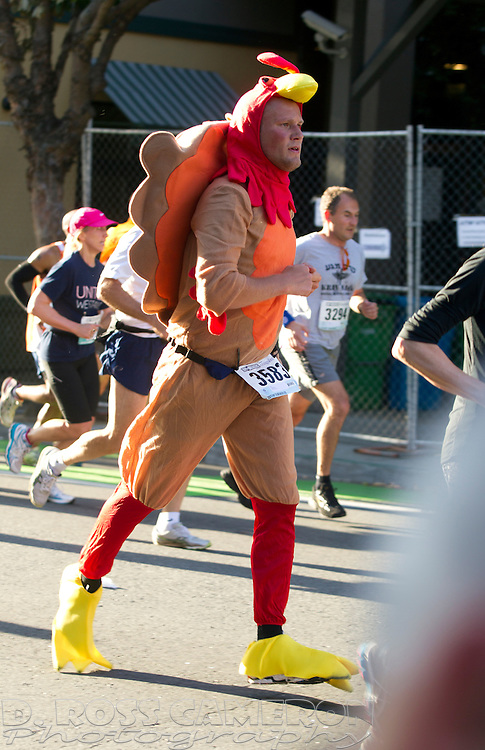 Dressed as a chicken, Marc Maronde of Palo Alto, Calif. runs along Fell Street during the 102nd Bay to Breakers 12K in San Francisco, Sunday, May 19, 2013. More than 30,000 runners -- from the elite to the weekend warrior -- made the 7.62-mile trek from Howard and Spear to the Great Highway. (Photo by D. Ross Cameron)