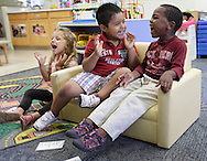 Errol McKinson, right, Carlos Granados, center, and Sila Munoz enjoy a sing-along at the Early Head Start program in Woodbourne on Tuesday, July 23, 2013.
