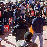 041113       Cable Hoover<br /> <br /> Council delegate Dwight Witherspoon, right, tries to explain the Navajo Generating Station proposal to a crowd of protesters and NGS employees at the Navajo Nation Council Chambers in Window Rock Thursday.