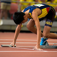 Roysius Tay (#148) of ACS(I) runs the first leg in the C Division boys' 4x100m relay final. (Photo © Eileen Chew/Red Sports)