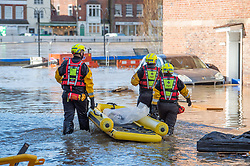 © Licensed to London News Pictures. 26/02/2020. Bewdley, UK. Rescuers with a small inflatable boat in the village of Wribbenhall on the eastern side of the Severn in Bewdley. Photo credit: Peter Manning/LNP