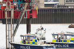 © Licensed to London News Pictures. 25/07/2020. London, UK. Three Extinction Rebellion activists have locked on to a drilling rig in the Thames close to the 02 Arena in Greenwich. The rig is involved with preparatory drilling for the Silvertown Tunnel which is planned to connect the Greenwich Peninsula with west Silvertown. Extinction Rebellion oppose the building of the tunnel due to the increase air pollution it may cause. Photo credit: George Cracknell Wright/LNP