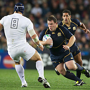 Alllan Jacobsen, Scotland, runs at James Haskell, England, during the England V Scotland Pool B match during the IRB Rugby World Cup tournament. Eden Park, Auckland, New Zealand, 1st October 2011. Photo Tim Clayton...