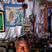 The medicine-man uses cocoa (beans, roots and leaves) to make up one of his potions. Huixtla, Mexico.