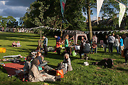 Members of the campaign to save nearby Carnegie Library in Herne Hill and closed by Lambeth council, organise a pop-up library and party in Ruskin Park, SE24.
