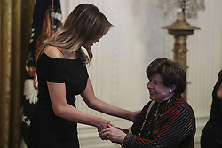 First Lady Melania Trump greets holocaust survivors during a Hanukkah reception with President Donald Trump in the East Room of the White House on December 6, 2018 in Washington, DC. Behind Trump, Vice President Mike Pence. (Photo by Oliver Contreras/SIPA USA)
