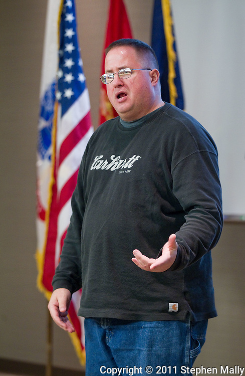 """Ted John, of Iowa City, performs his section of """"The Telling Project"""" where he talks about his experiences in Desert Storm and Desert Shield during the University of Iowa Veterans Reception at the Old Capitol Mall in Iowa City on Wednesday evening, November 9, 2011. John, who served in the Marine Corps from 1986-1992, is a non-traditional student at the University of Iowa. (Stephen Mally/Freelance)"""