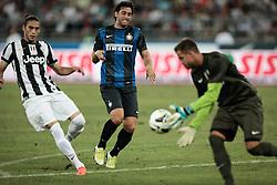 Bari (BA) 21.07.2012 - Trofeo Tim 2012. Inter - Juventus. Nella Foto: Caceres sx (J), Milito centro (I) e Storari (J)