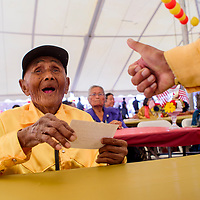 Code Talker William T. Brown smiles at a thumbs up from fellow Code Talker Peter MacDonald during the Navajo Code Talker Day celebration in Window Rock Monday.