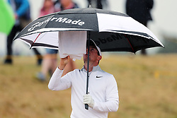Northern Ireland's Rory McIlroy adjusts his towel and umbrella during day two of The Open Championship 2018 at Carnoustie Golf Links, Angus.