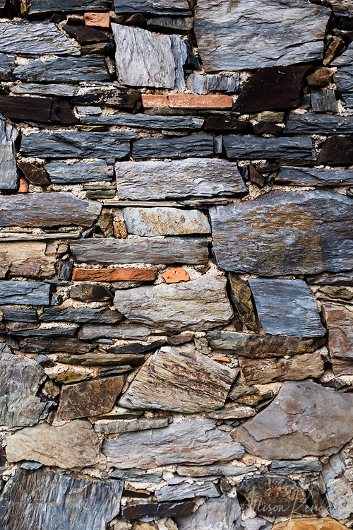 Details of skillfully stacked stone walls and steps in Vernazza, Italy on the Cinque Terre coast of Liguria