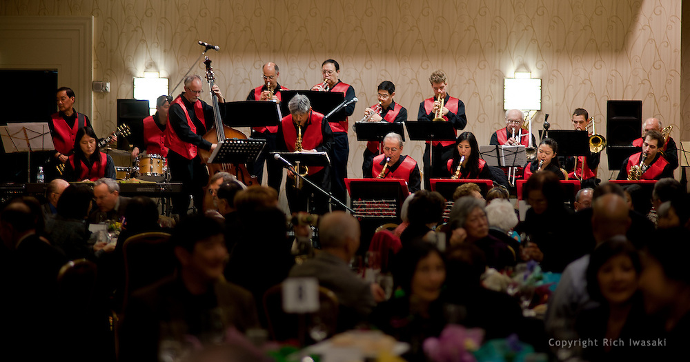 """The Minidoka Swing Band performs in the ballroom at Portland Marriott Downtown Waterfront hotel, Portland, Oregon. The evening event, """"An Intimate Dinner with Geoge Takei"""", was sponsored by Oregon Nikkei Endowment."""