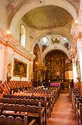 Chapel interior, Mission San Xavier del Bac, Tohono O'odham Indian Reservation, Tucson, Arizona USA