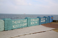 Quote from James Joyce's A portrait of an artist as a young man 'the first faint noise of gently moving water broke the silence, low & faint & whispering' painted on the wall ad Dun Laoghaire Baths in Dublin Ireland