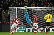 Jose Holebas of Watford's (R) has a shot at goal saved by Luke Steele , the goalkeeper of Bristol City (2L). The Emirates FA Cup, 3rd round match, Watford v Bristol City  at Vicarage Road in Watford, London on Saturday 6th January 2018.<br /> pic by Steffan Bowen, Andrew Orchard sports photography.