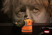 A billbord poster with a image of Prime Minister Boris Johnson and the word SHAME goes up November 3rd 2020 in Hackney, London, United Kingdom. The artwork is by the artist Subvertiser.