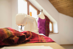 Sewing machine with clothes in clothes shop, Bavaria, Germany