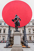 Symphony for my Beloved Daughter, 2018, by Anish Kapoor towers above the statue with traditional garland of flowers in teh courtyard - Royal Academy celebrates its 250th Summer Exhibition, and to mark this momentous occasion, the exhibition is co-ordinated by Grayson Perry RA.