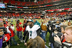 Philadelphia Eagles quarterback Michael Vick #7 is surrounded by Media after the NFL game between the Philadelphia Eagles and the Atlanta Falcons on December 6th 2009. The Eagles won 34-7 at The Georgia Dome in Atlanta, Georgia. (Photo By Brian Garfinkel)