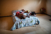 On Friday (the equivalent of Sunday in Muslim Djibouti), Lula and Nadja, 2 ethiopian prostitutes, recover from last night out. Khat keeps the young women awake at night: the drug has a stimulant effect..  Recovering from the night, Most girl eat Khat to stay up all night...One of the communal home of escort girls and prostitutes, in Djibouti. Most of them find their clients in bars and discos. Most of their clients are military people and workers from various nationalities...The geostrategical and geopolitical importance of the Republic of Djibouti, located on the Horn of Africa, by the Red Sea and the Gulf of Aden, and bordered by Eritrea, Ethiopia and Somalia.