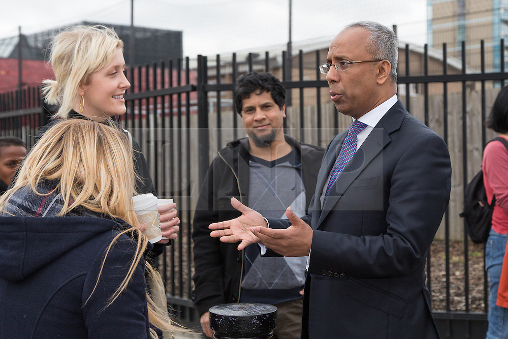 """© Licensed to London News Pictures. 05/04/2014. London, UK. Mayor of Tower Hamlets, Lutfur Rahman speaks to local residents during a community walkabout in Stepney, East London on 5th April 2014 to canvas for the upcoming Mayoral election. Communities Secretary, Eric Pickles yesterday sent inspectors to start an audit of Tower Hamlets council and the Rahman administration following allegations of fraud and financial mismanagement, also reported by BBC's Panorama programme this week. Mayor Lutfur Rahman denies all allegations, which he calls """"Panorama lies"""". Photo credit : Vickie Flores/LNP"""