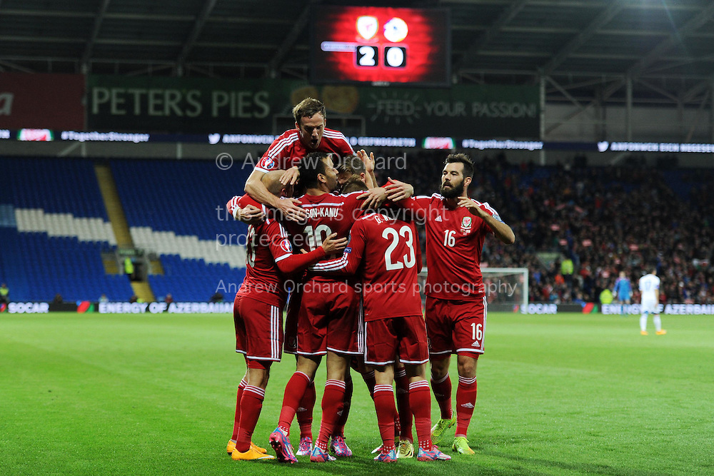 Hal Robson-Kanu of Wales © celebrates with his team mates after he scores his teams 2nd goal. Euro 2016 qualifying group B match, Wales v Cyprus at the Cardiff city Stadium in Cardiff, South Wales on Monday 13th Oct 2014.<br /> pic by Andrew Orchard, Andrew Orchard sports photography.