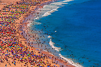 Overview of large crowds of people enjoying Copacabana Beach during Carnaval, Rio de Janeiro, Braizl.