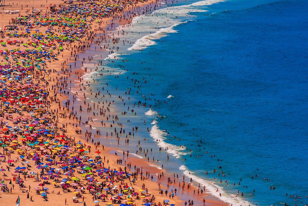 Overview of large crowds of people enjoying Copacabana Beach during Carnaval, Rio de Janeiro, Braizl.