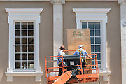 Workers use plywood to cover windows in preparation for Hurricane Irma on the historic Customs House along Broad Street September 8, 2017 in Charleston, South Carolina. Imra is expected to spare the Charleston area but hurricane preparations continue as Irma leaves a path of destruction across the Caribbean.