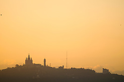 City silhouette skyline church sunset golden