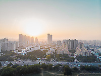 Aerial view of Sohna road overlooking a residential neighbourhood in sector 49 Gurgaon during golden hour in Delhi ncr, India.