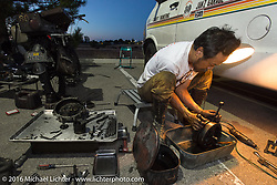 Shinya Kimura works on his Team 80 1915 Indian Twin during Stage 13 (257 miles) of the Motorcycle Cannonball Cross-Country Endurance Run, which on this day ran from Elko, NV to Meridian, Idaho, USA. Thursday, September 18, 2014.  Photography ©2014 Michael Lichter.