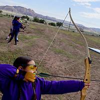 Karliz Castañeda competes in the archery contest during the Bi-County Fair Saturday in Prewitt.