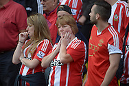 a worried looking Southampton fan looks on during the second half. Barclays Premier League, Watford v Southampton at Vicarage Road in London on Sunday 23rd August 2015.<br /> pic by John Patrick Fletcher, Andrew Orchard sports photography.