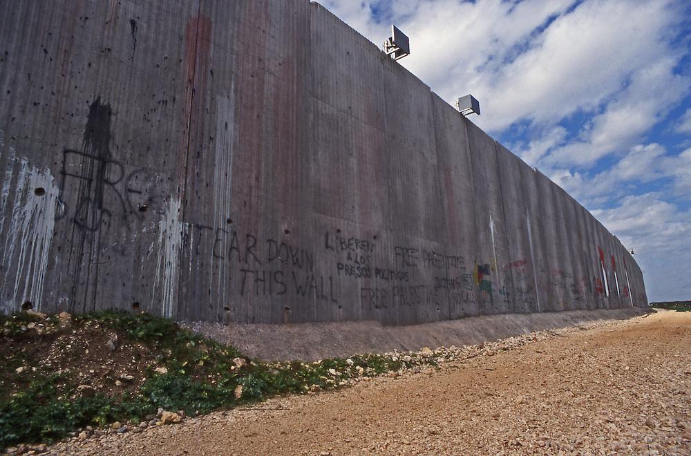 Israeli 34 foot high concrete separation wall stops trade between Palestinian town of Qalqilya and Israel.