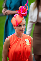 © London News Pictures. 18/06/2013. Ascot, UK.  Singer Katherine Jenkins and Garry Linerer attending day one of Royal Ascot at Ascot racecourse in Berkshire, on June 18, 2013.  The 5 day showcase event,  which is one of the highlights of the racing calendar, has been held at the famous Berkshire course since 1711 and tradition is a hallmark of the meeting. Top hats and tails remain compulsory in parts of the course. Photo credit should read: Ben Cawthra/LNP