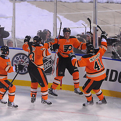Philadelphia Flyers center Brayden Schenn (10) celebrates his goal, the first of his NHL career and the game, with teammates Jakub Voracek (93) and Andrej Meszaros (41) and Max Talbot (41) during second period NHL Winter Classic action between the New York Rangers and Philadelphia Flyers at Citizens Bank Park. The Rangers defeated the Flyers 3-2.